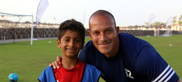 Bobby Zamora with football camp participant